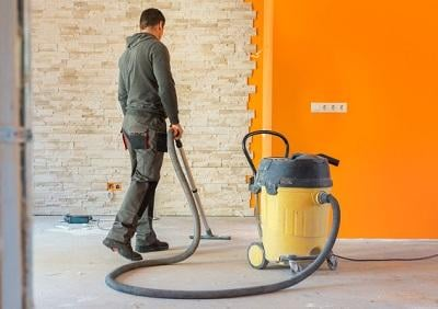 Man Vacuuming a Construction Site
